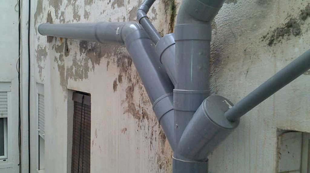 distribución bajantes de agua en Edificios